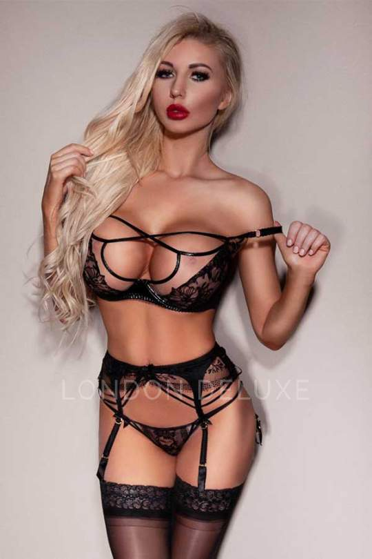 Stunning blonde escort Scarlett in black lingerie