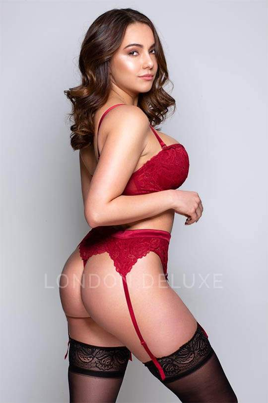 Riley showing off her bum in red lingerie and black stockings