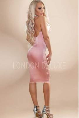 Chrisa posing in a pink dress
